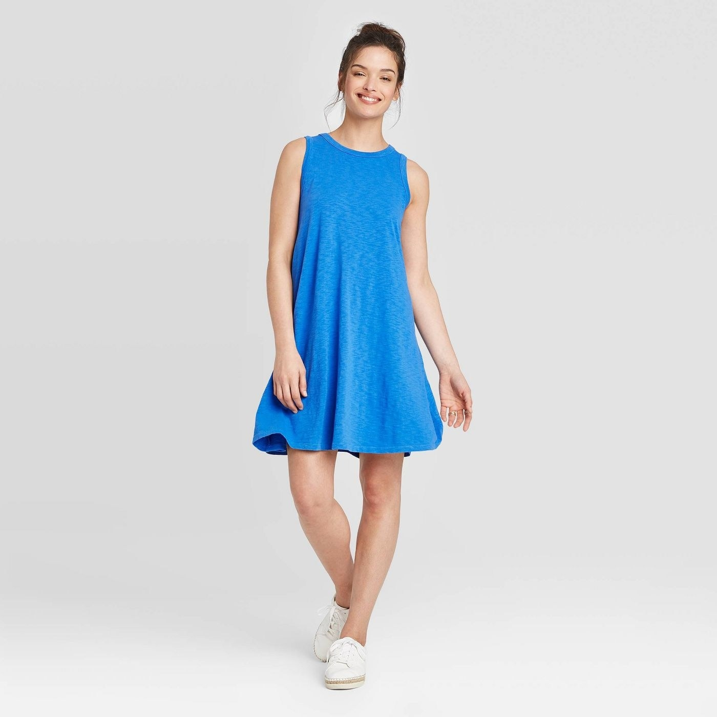A blue dress with a hem just above the knee