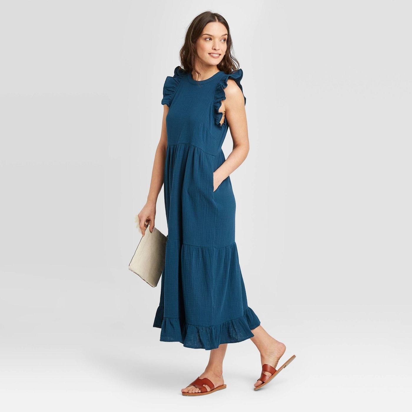 A model in the blue dress, which has pockets