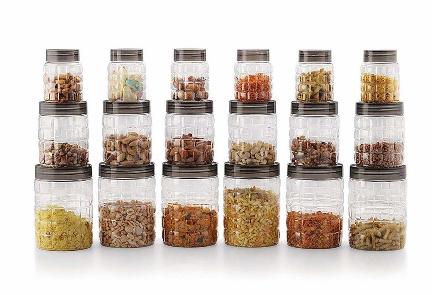 Multiple clear canisters with food items in them.