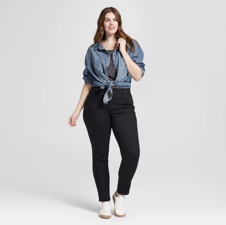 Model wearing the black, trouser-like jeggings