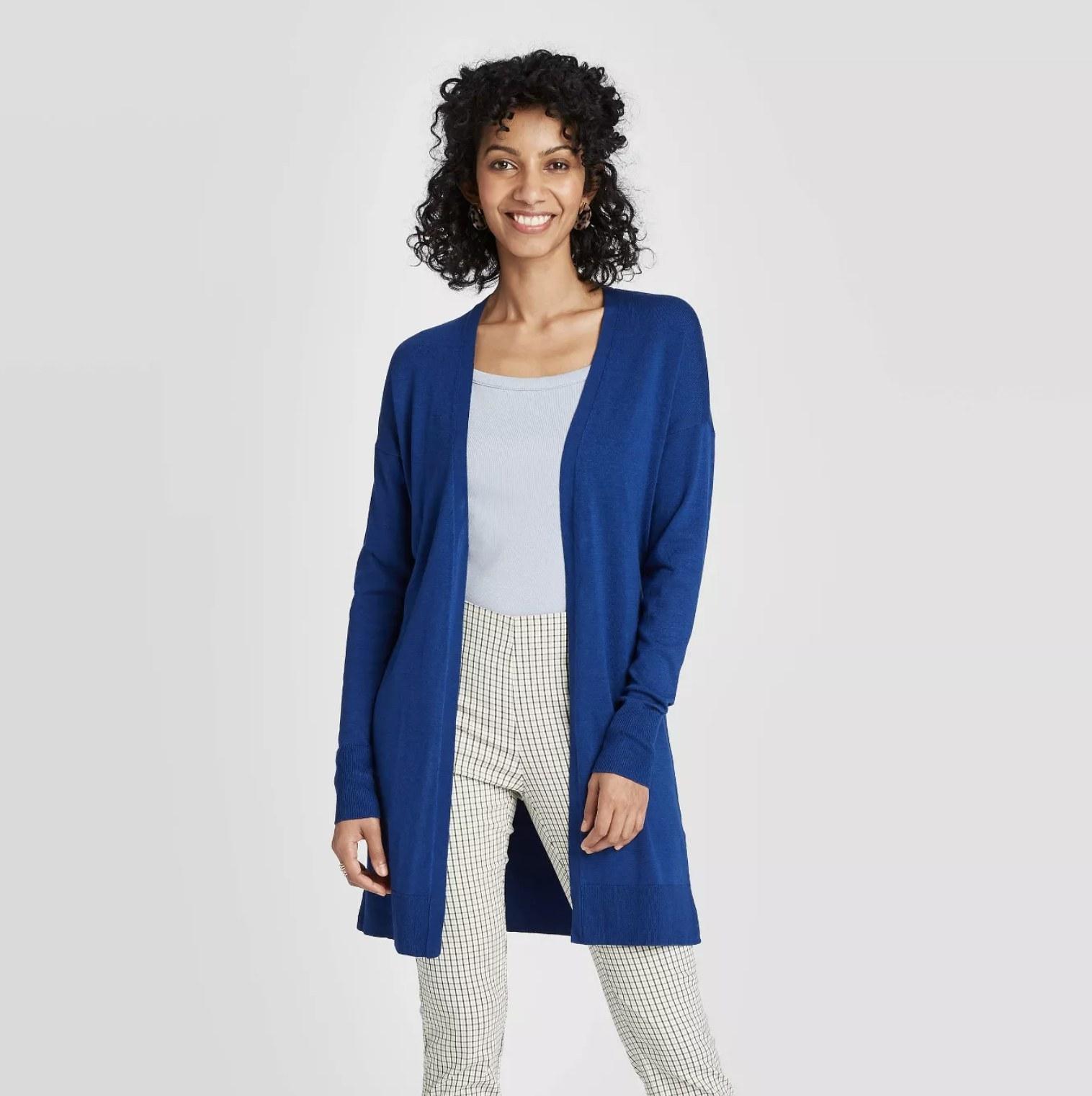 Model wearing the long open cardigan in royal blue