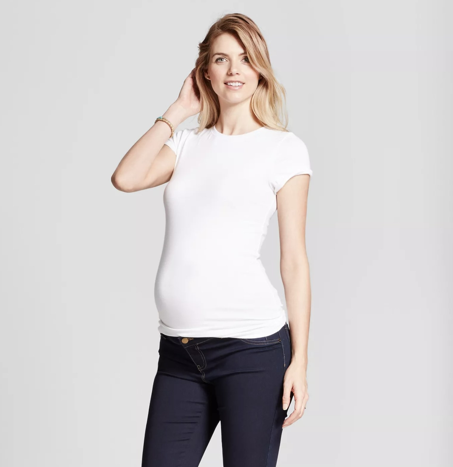 Pregnant model wearing the white T-shirt
