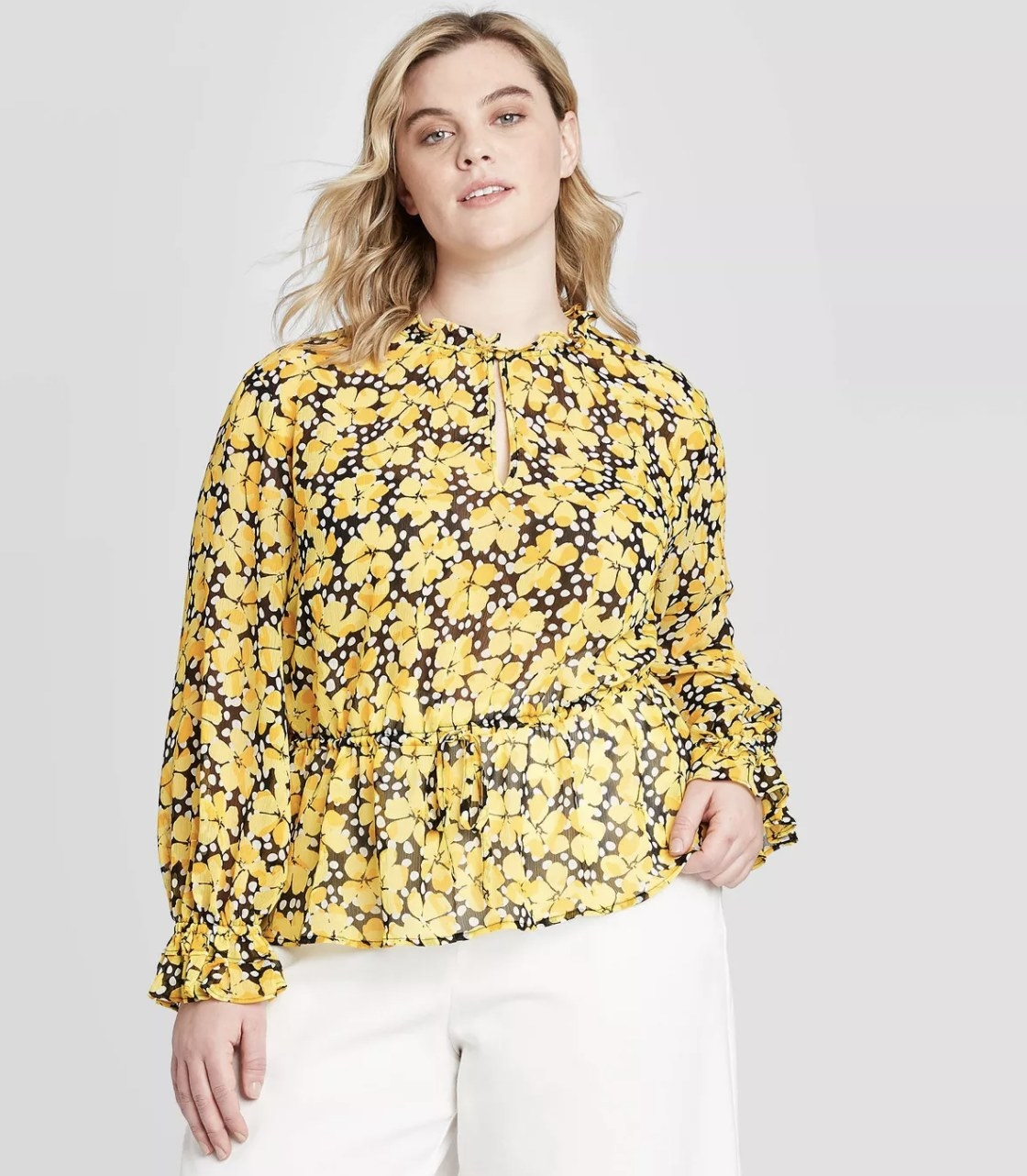 Model wearing the yellow floral blouse