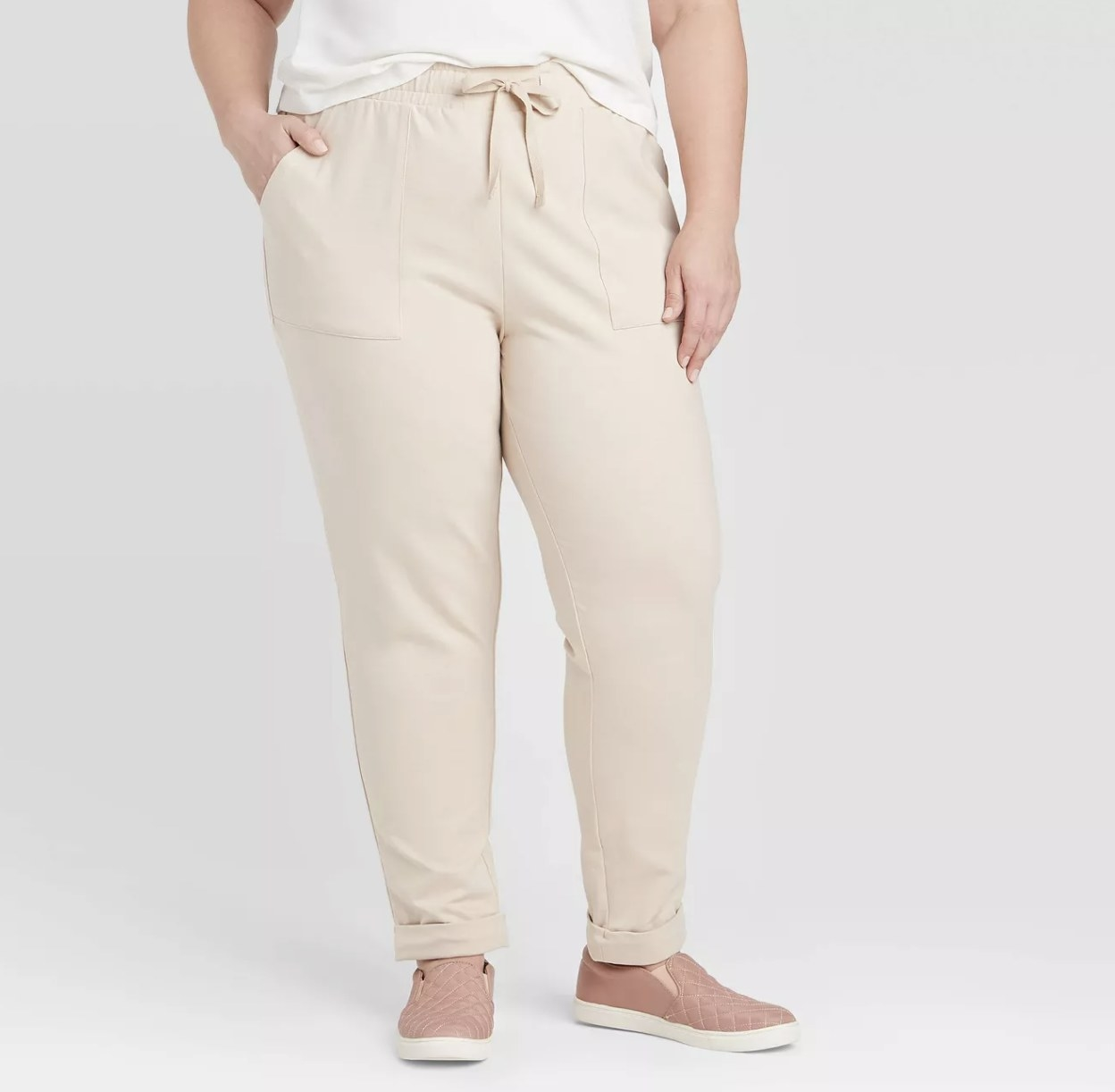 Model wearing the cream joggers
