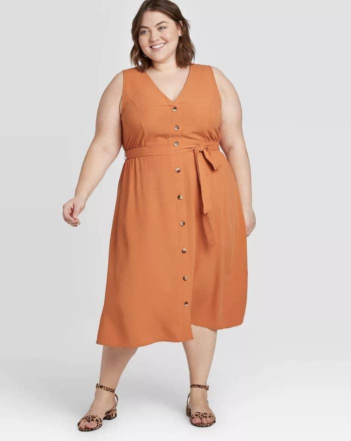 Model wearing the dress in orange