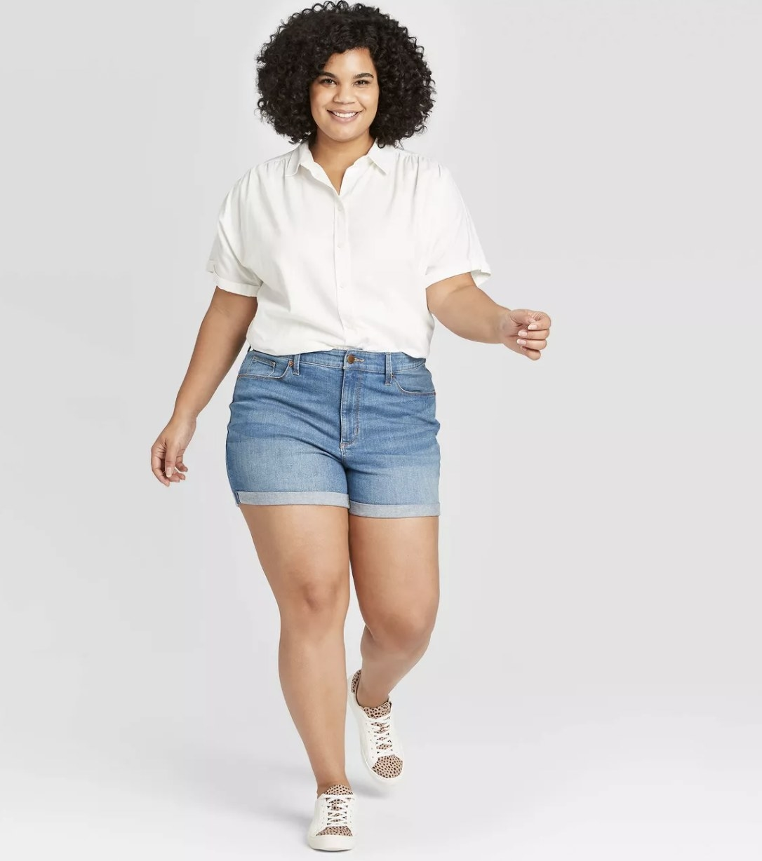 Model wearing the denim shorts
