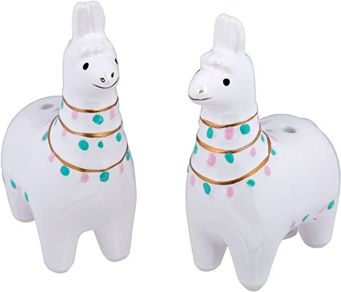 Two llamas that are salt and pepper shakers