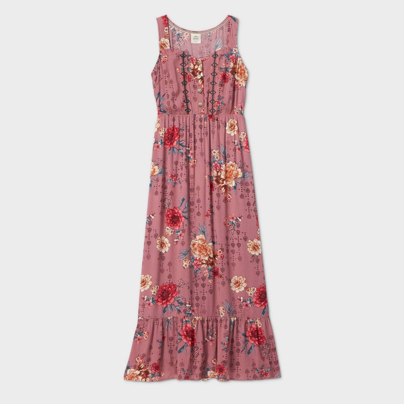 A pink floral sleeveless maxi with a ruffled hem and buttons on the chest