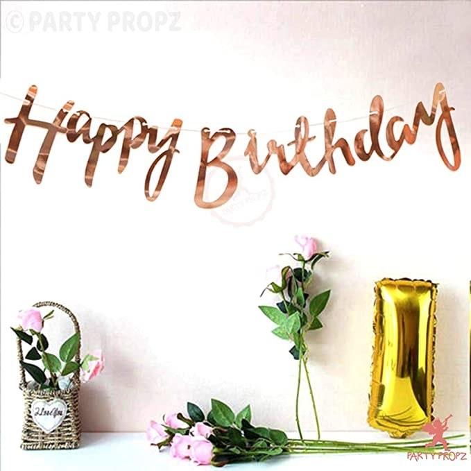 Rose gold foil 'Happy Birthday' banner