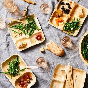 top down view of the wooden looking plates with food on them