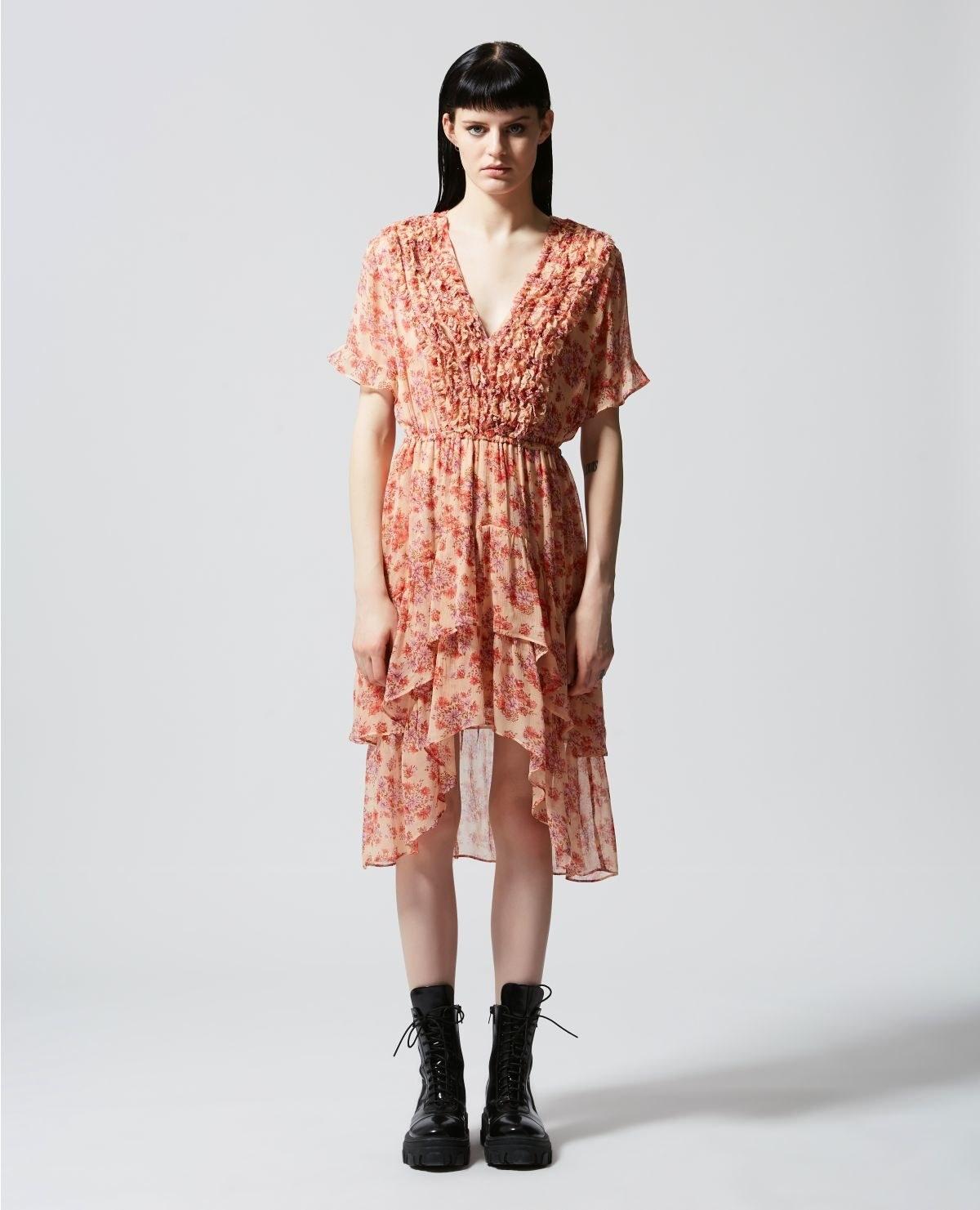 model wearing midi pink printed V-neck dress