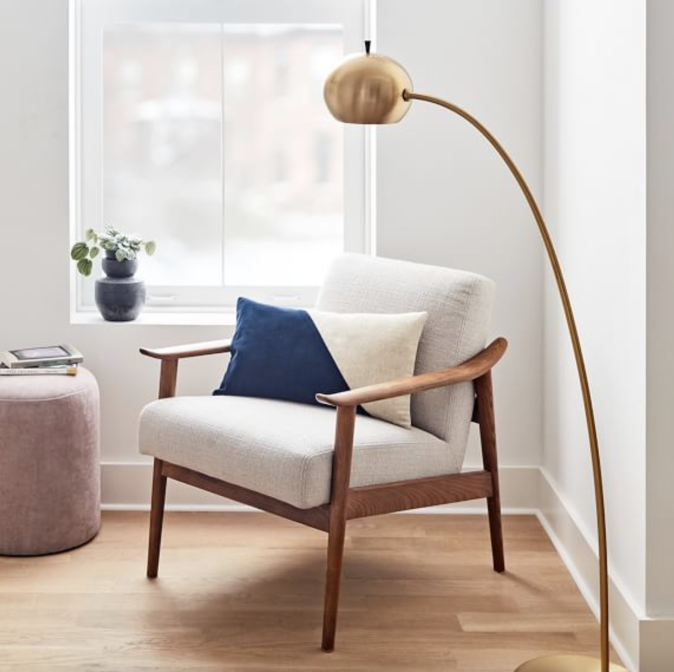mid-century wood chair with white upholstery