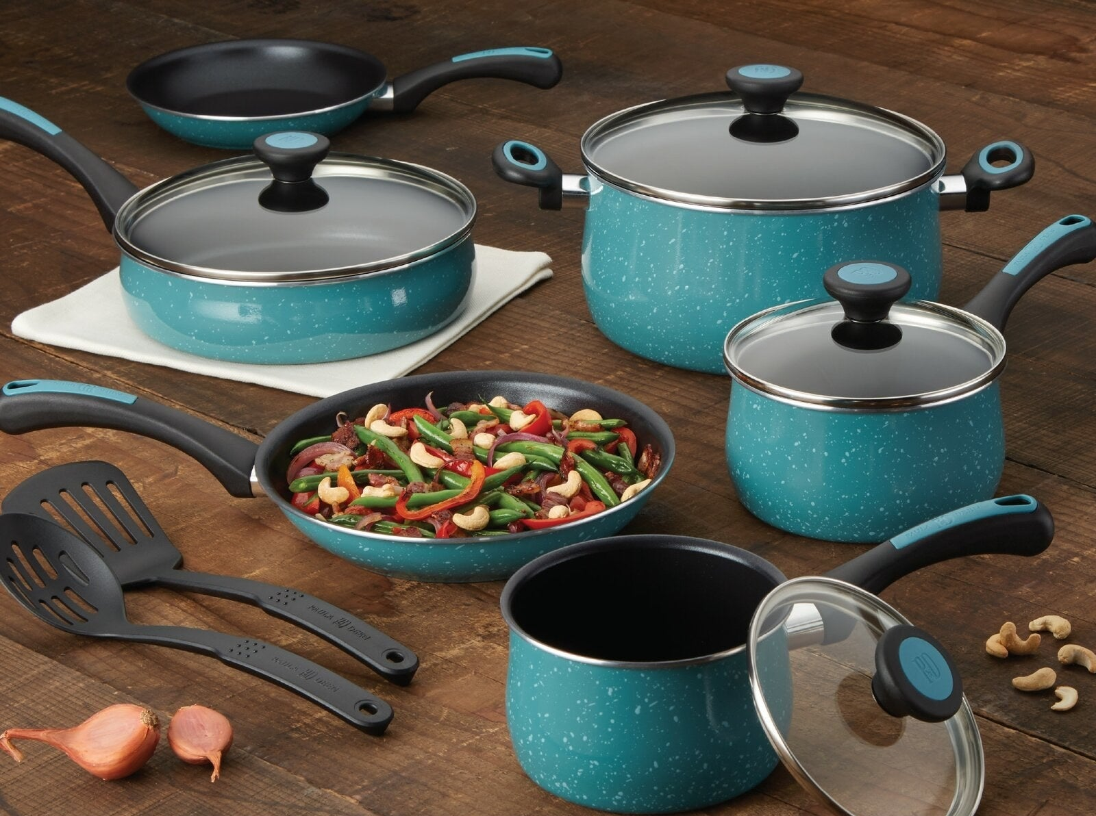 The cookware set in teal with speckled porcelain exterior