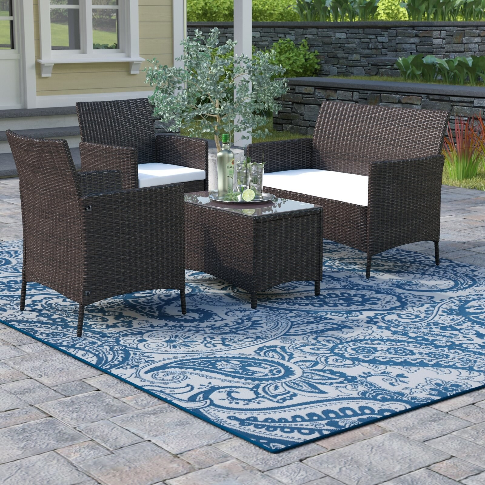 The matching rattan, dark brown set with white cushions