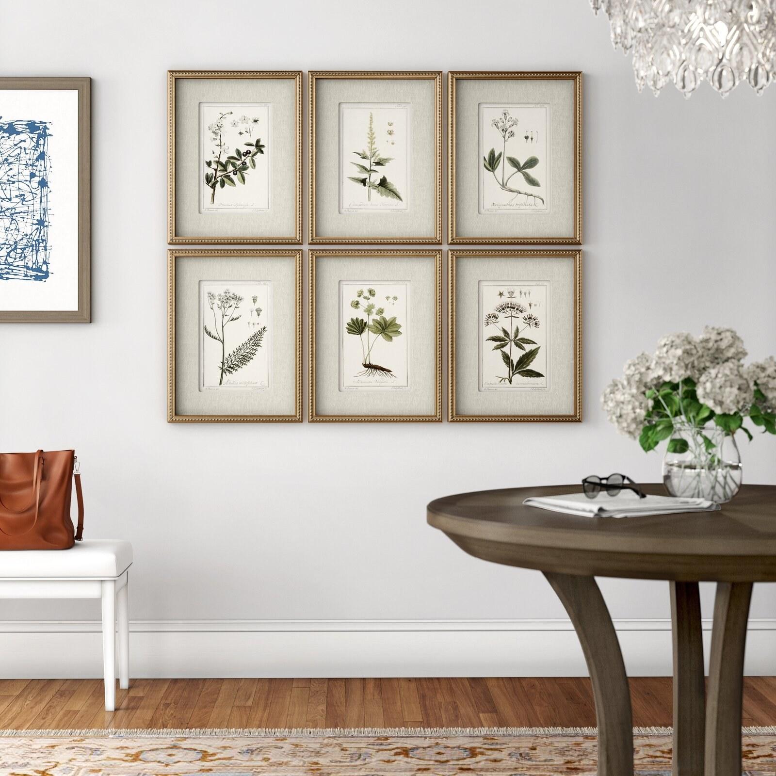 The gold-framed floral prints