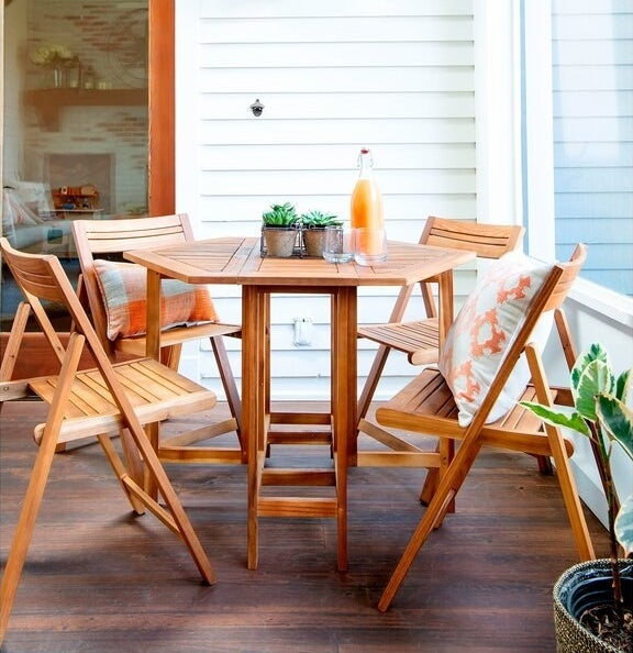 The hexagonal wooden table and matching folding chairs