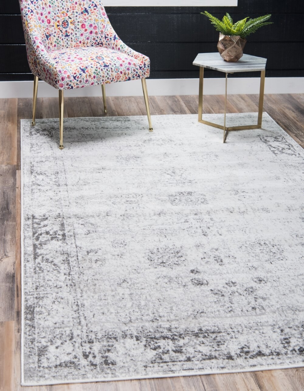 The large gray area rug