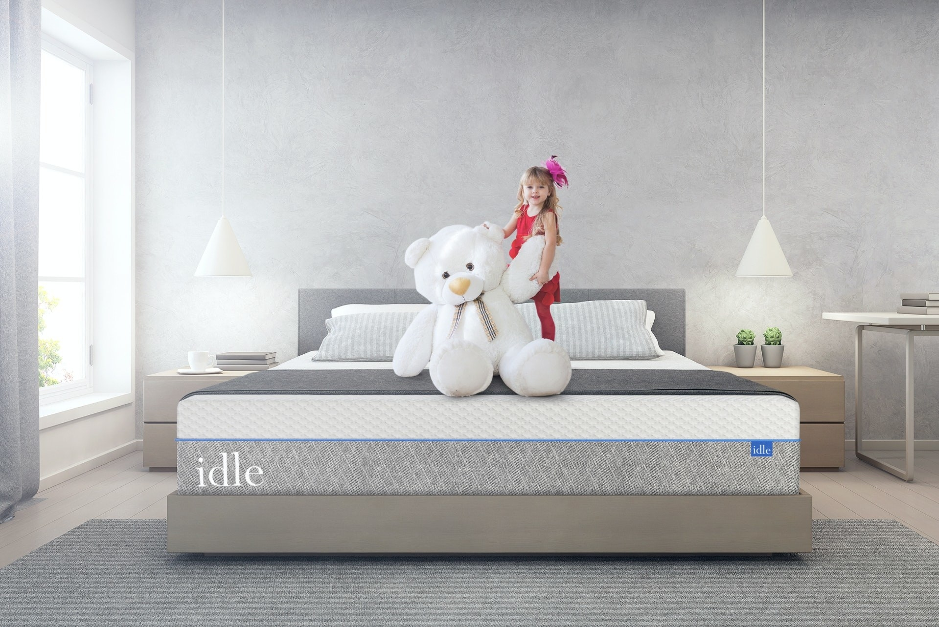child and teddy bear on mattress