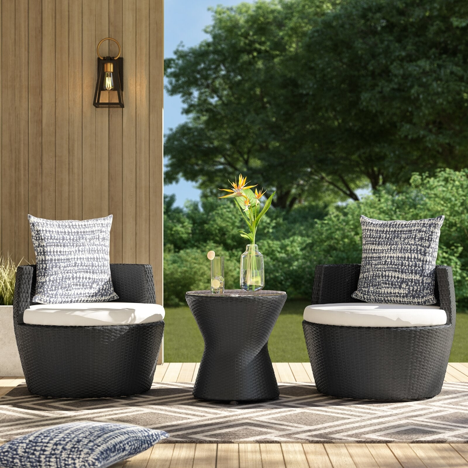 The small woven rattan table and two matching seats with foam-filled cushions