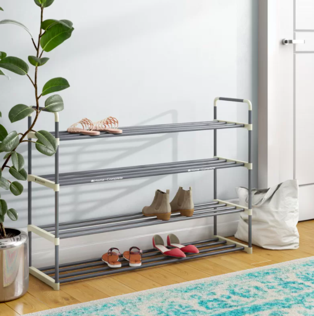 A silver four-tier shoe rack with sandals, boots, and flats