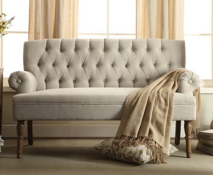 The tufted sofa in cream