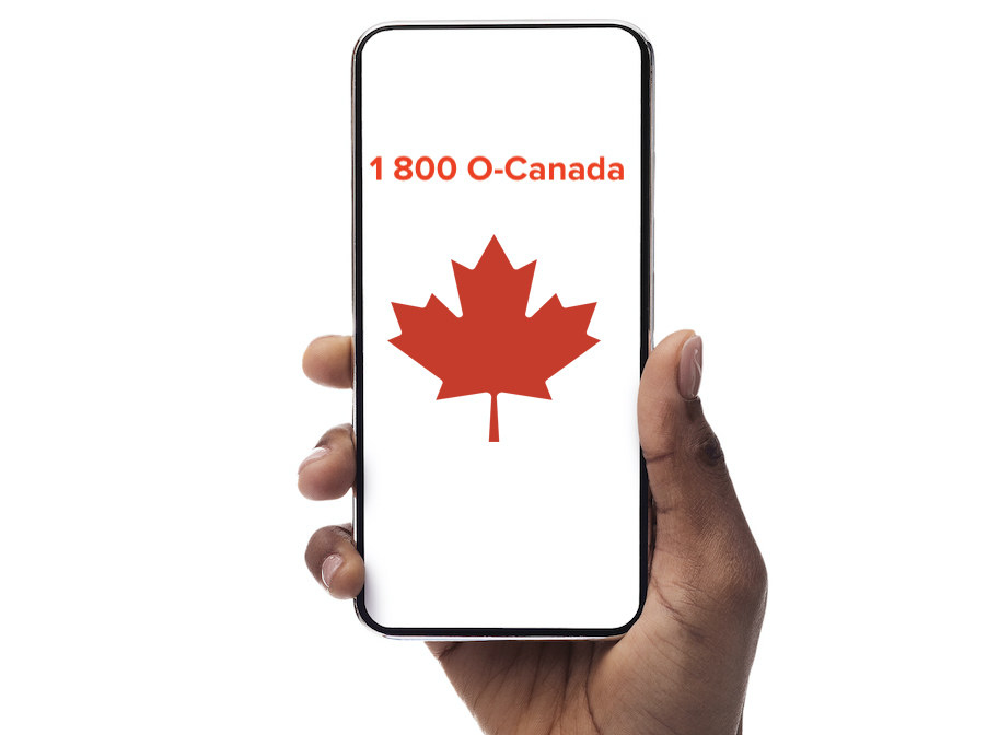 "Over a white background, a hand holds an iPhone. The iPhone screen reads, ""1-800-O-Canada"" and an image of a red maple leaf sits below it."