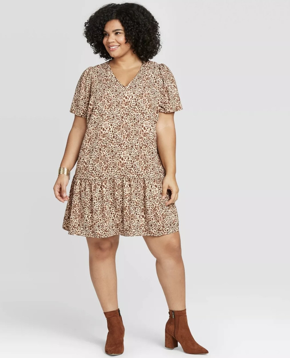 Model wearing the dress in a brown spotted print
