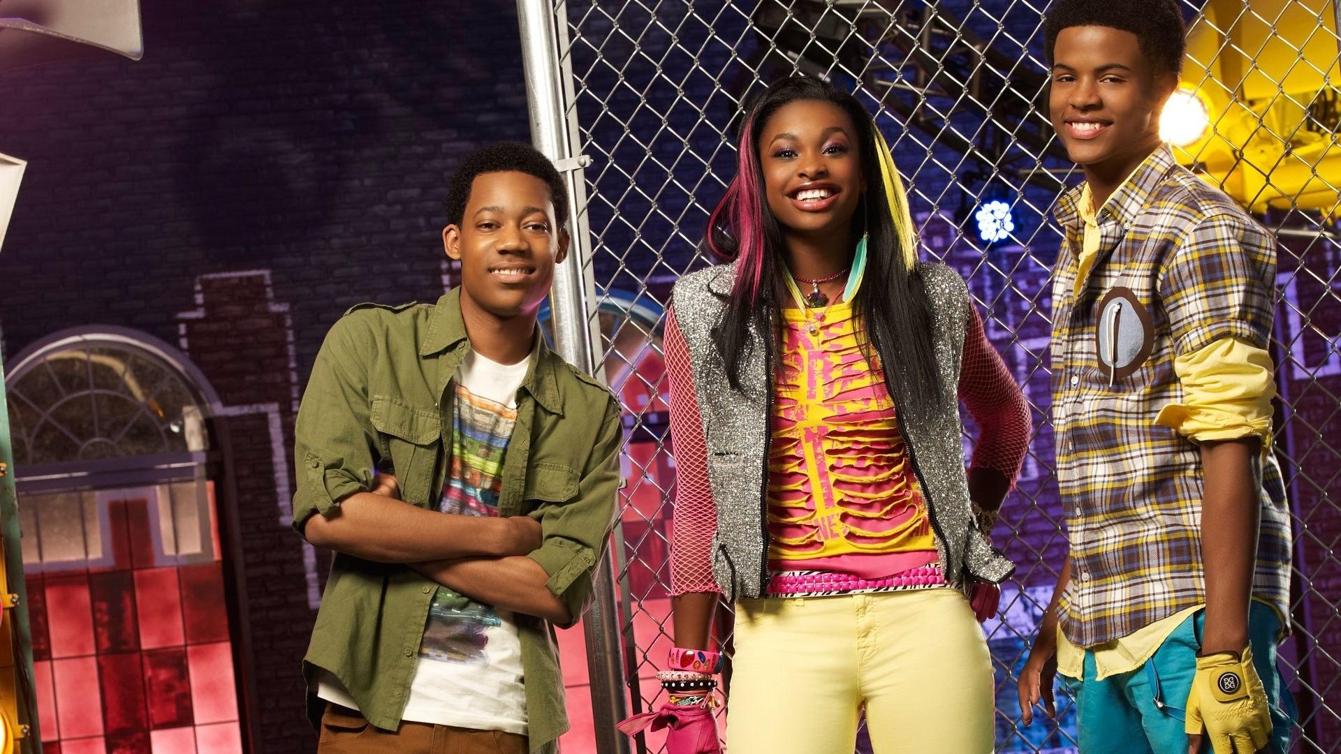 three teens posing before performing