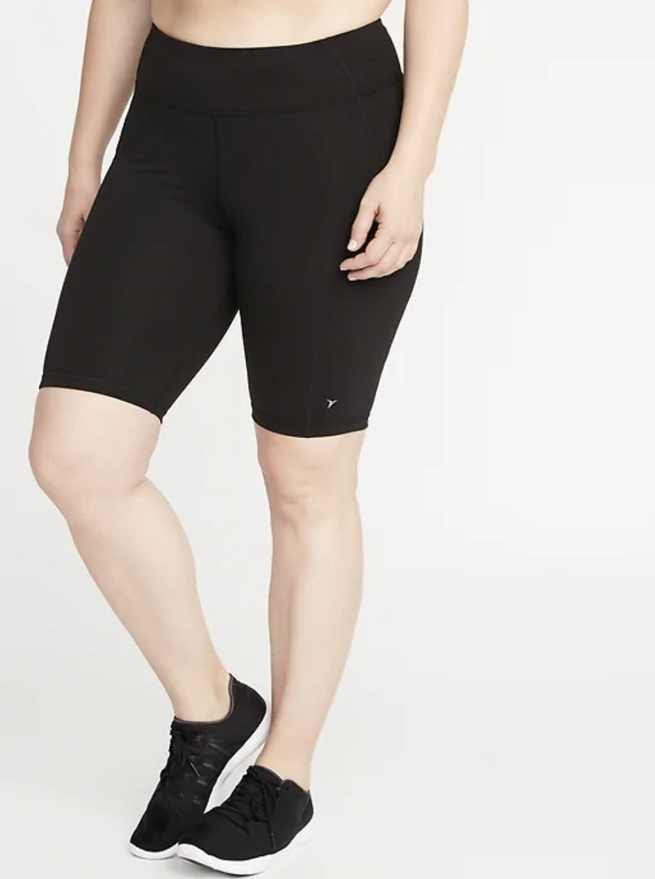 A model in black bike shorts that fall above the knee