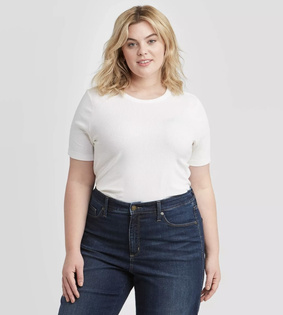 Model wearing the white shirt with jeans
