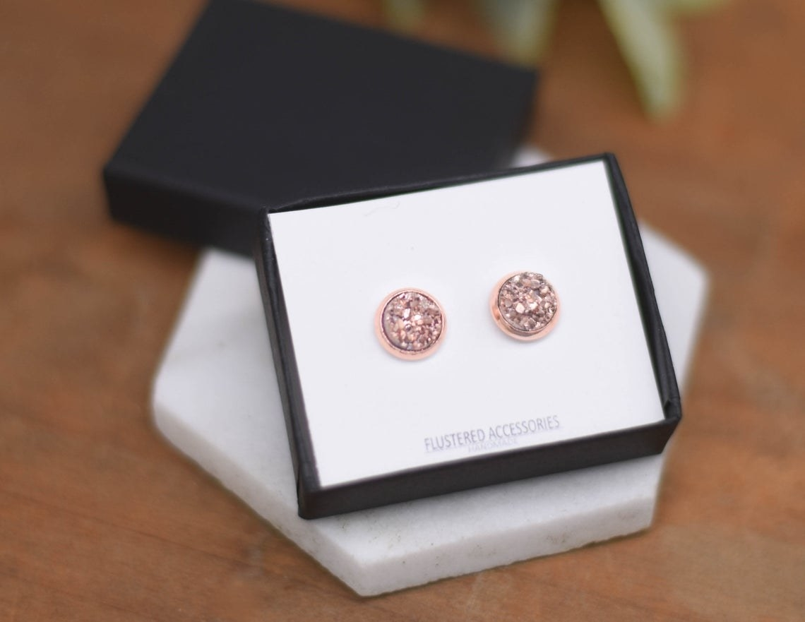 The rose gold druzy earrings.