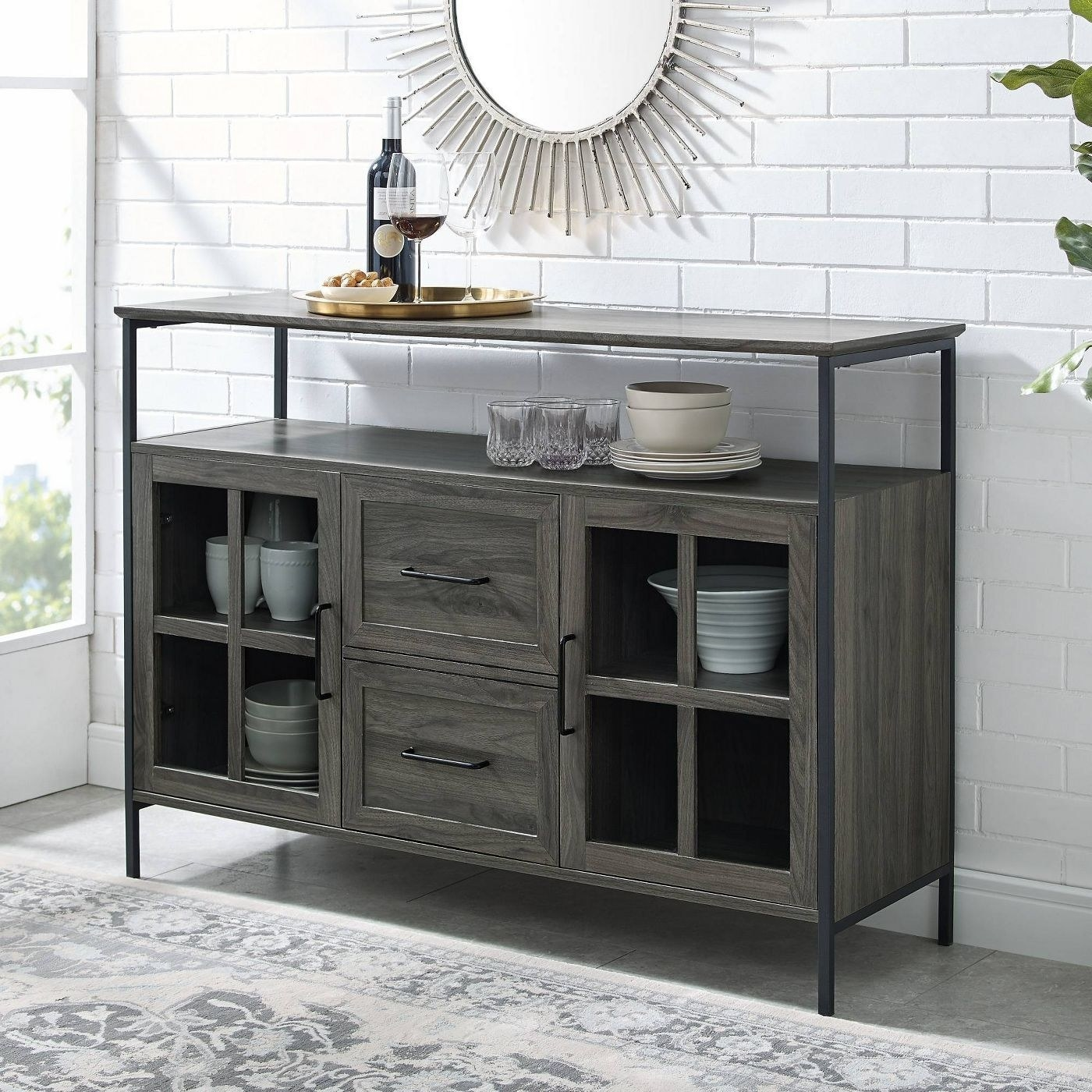 a greyish-brown buffet table with two tiers and lots of storage underneath