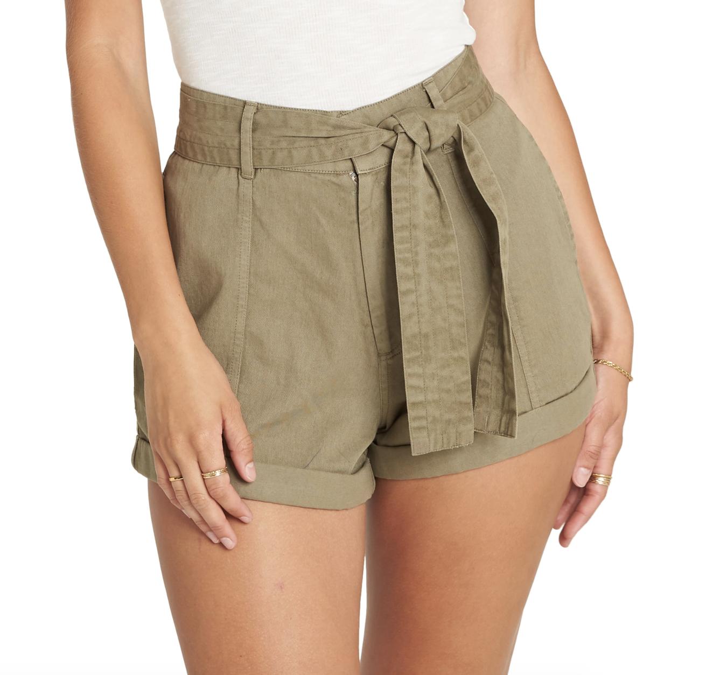 model wearing olive green belted shorts