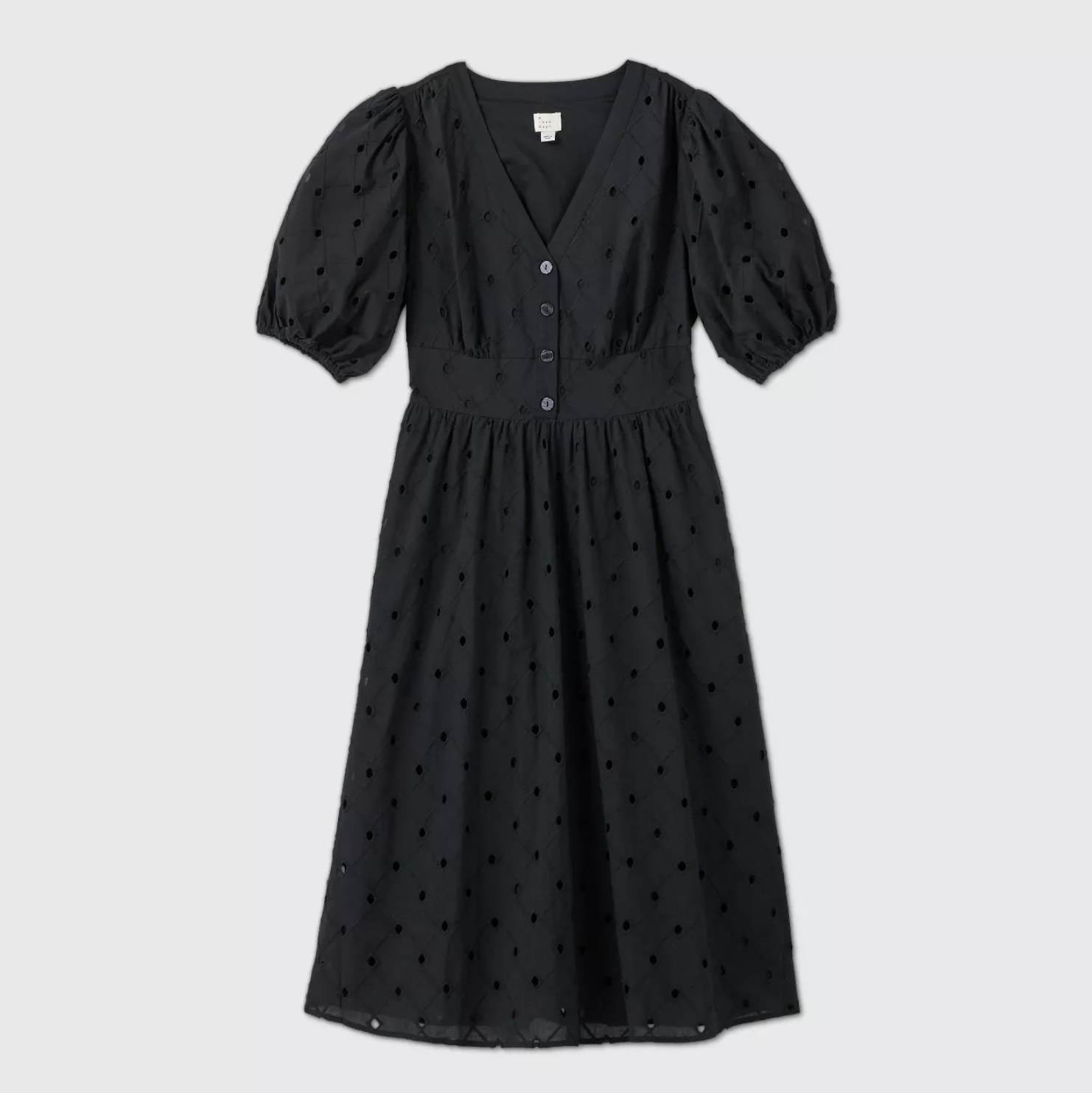 A black eyelet dress with four buttons in the front
