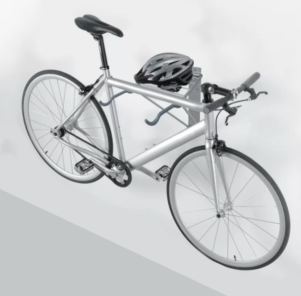Bike wall-mount holds up a silver bike and bicycle helmet