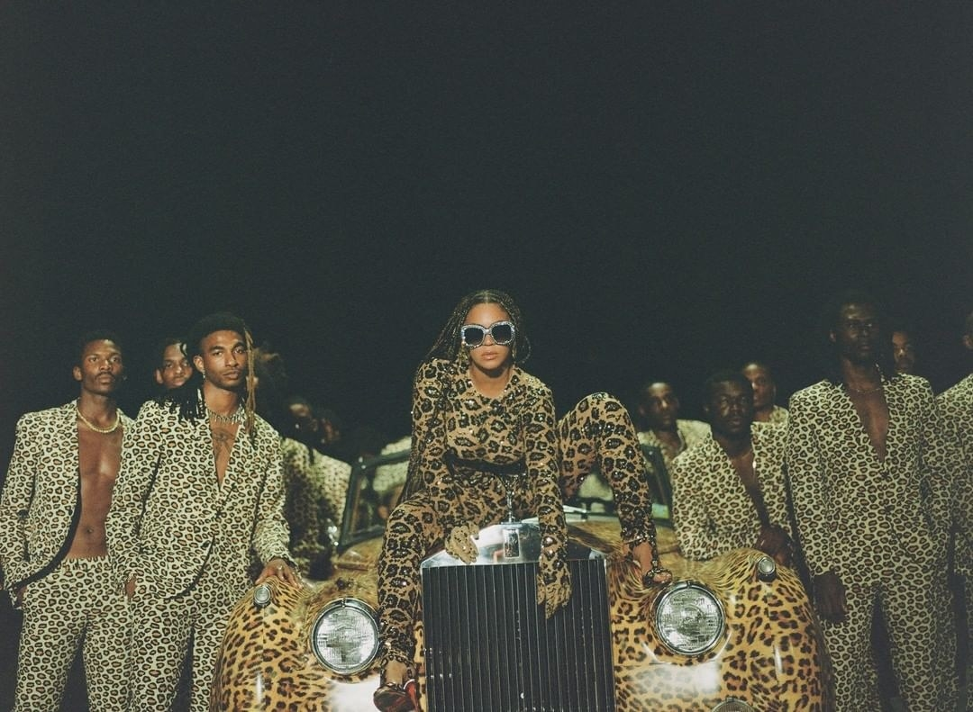 beyoncé crouching on a car in all leopard print