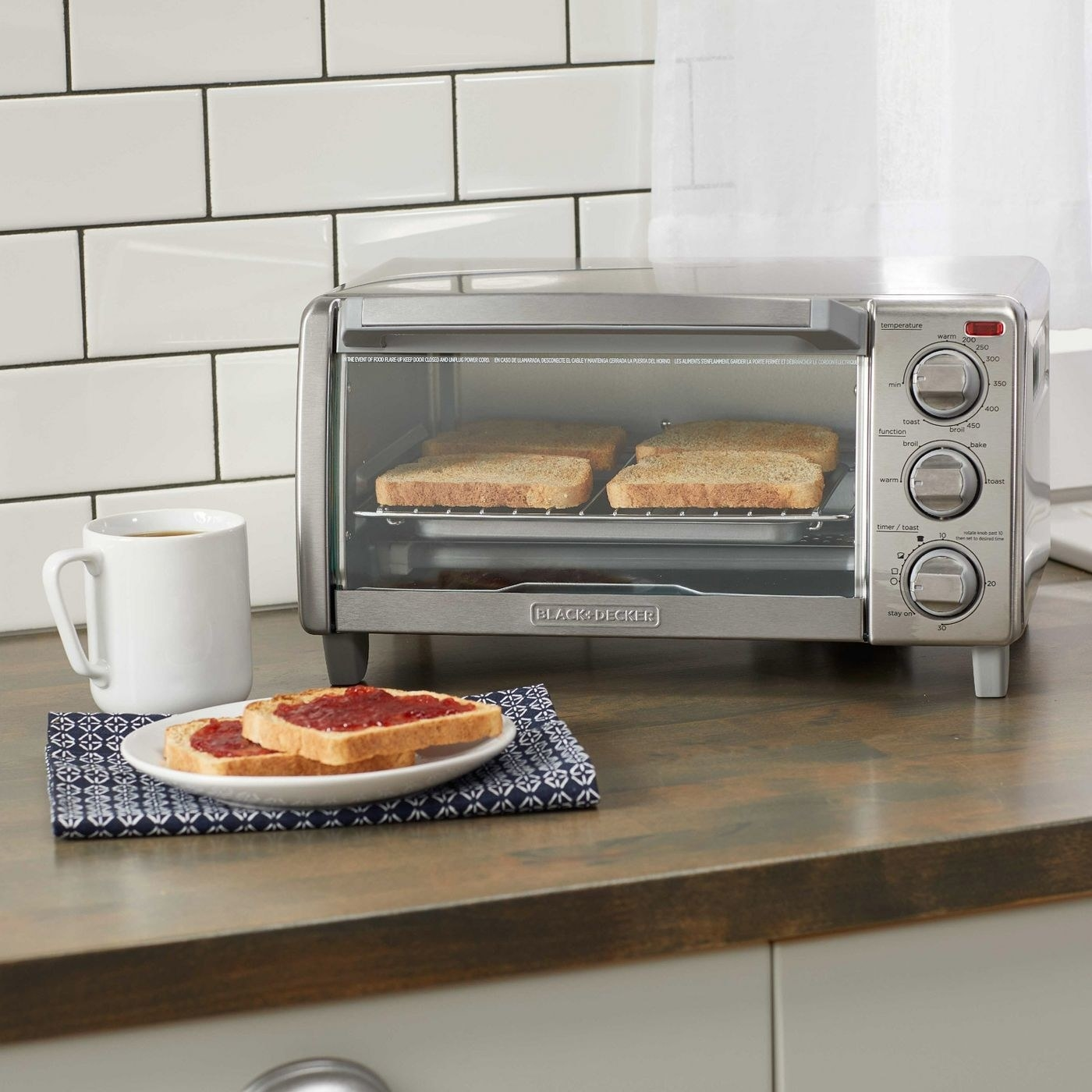 a stainless steel toaster with bread in it