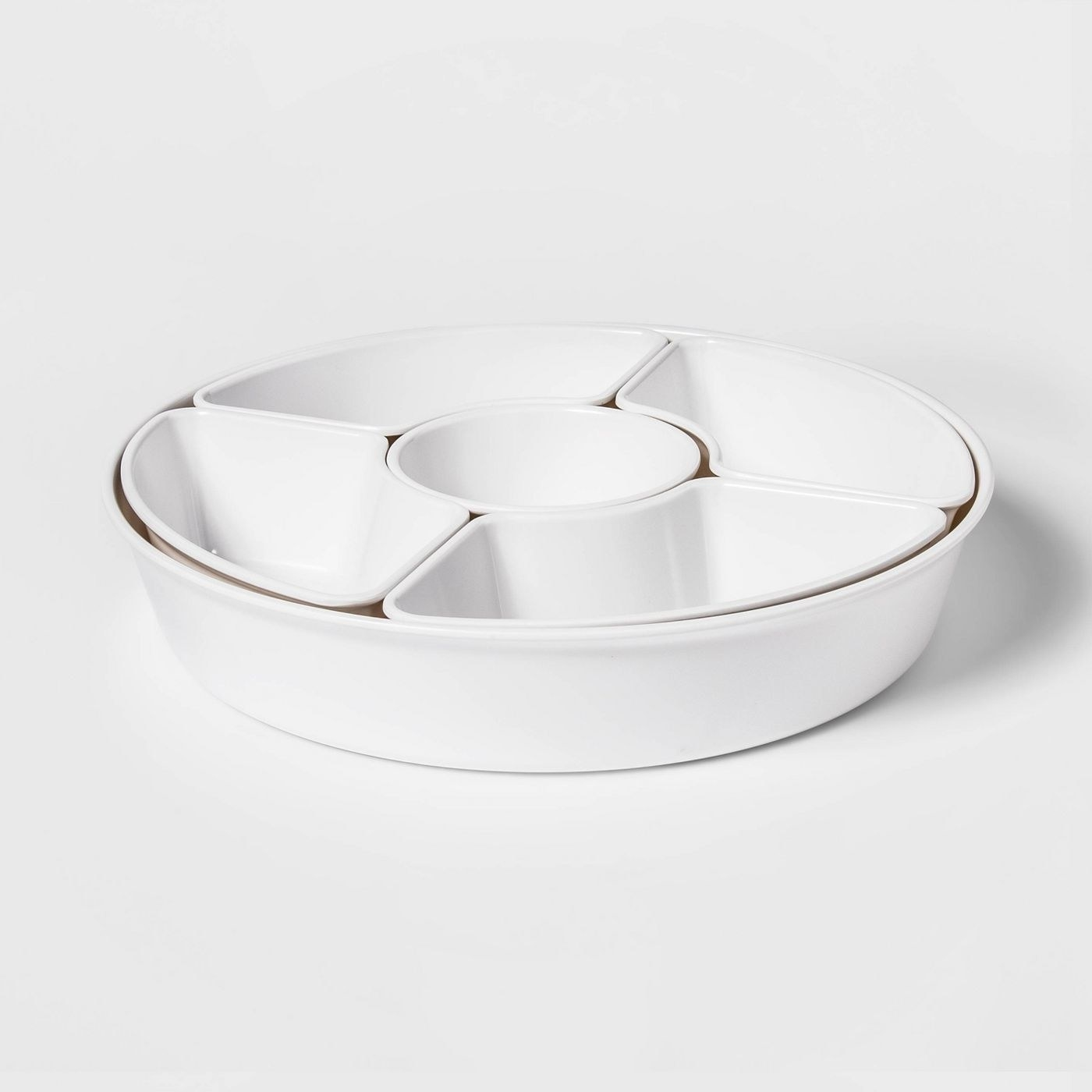 an all white serving platter with five compartments for dips and chips