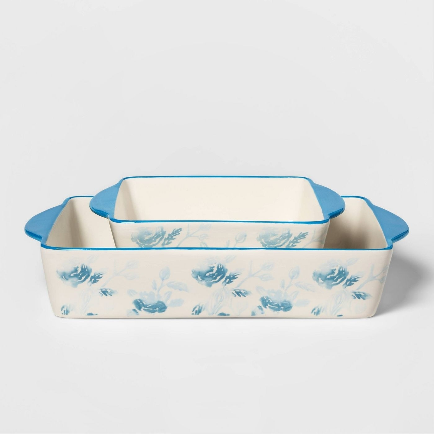 a ceramic casserole dish with light blue floral designs on it