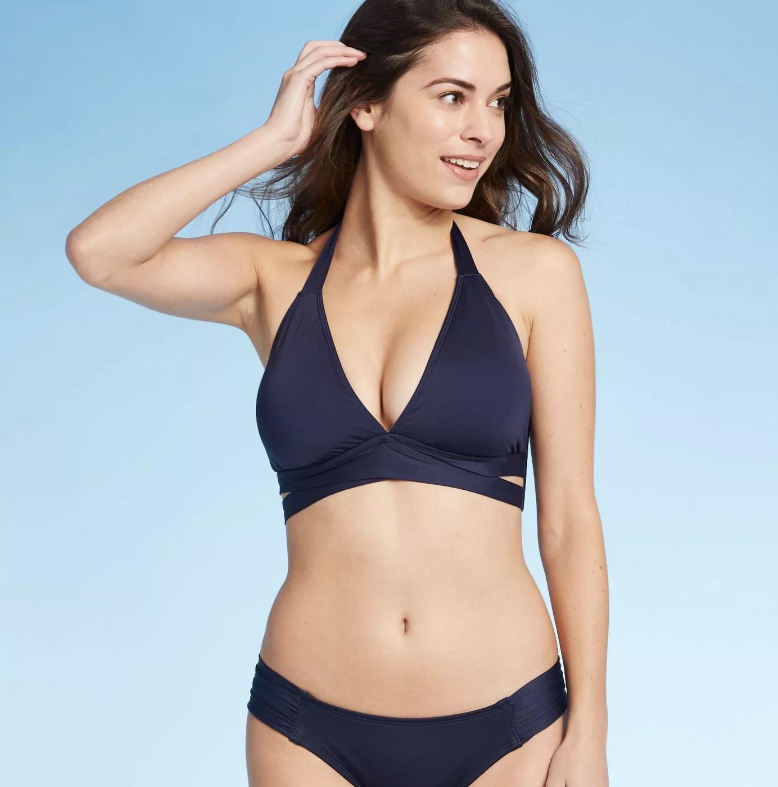 Model wearing the bikini top in blue