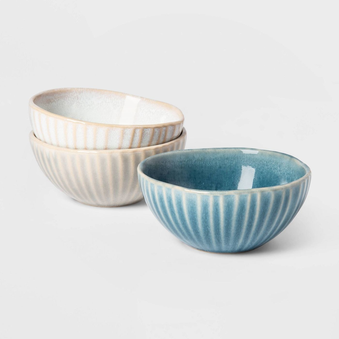 small condiment bowls with ridges around the edges and in white, grey, and blue