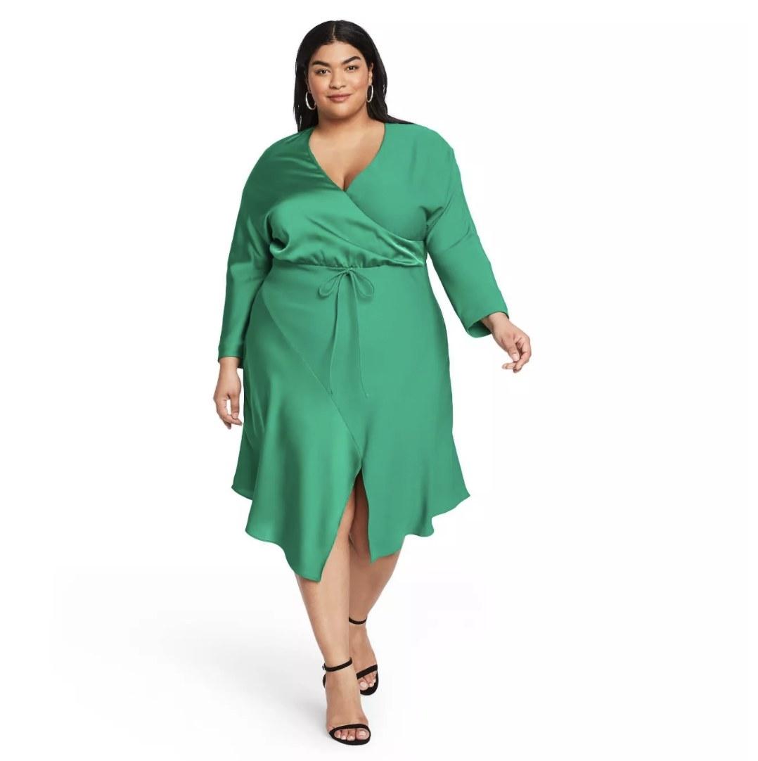 Model wearing the green dress