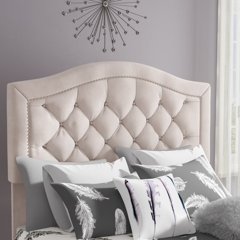 The headboard in cream, featuring a nailhead trim