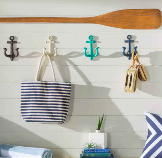 Brown, white, blue, and green nautical-themed hooks holding up accessories