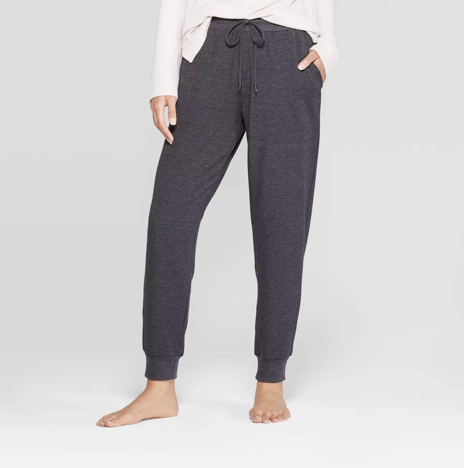 Model wearing the grey sweatpants