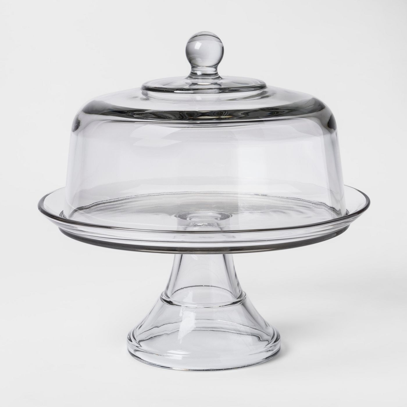 a class cake stand  with a glass covering dome