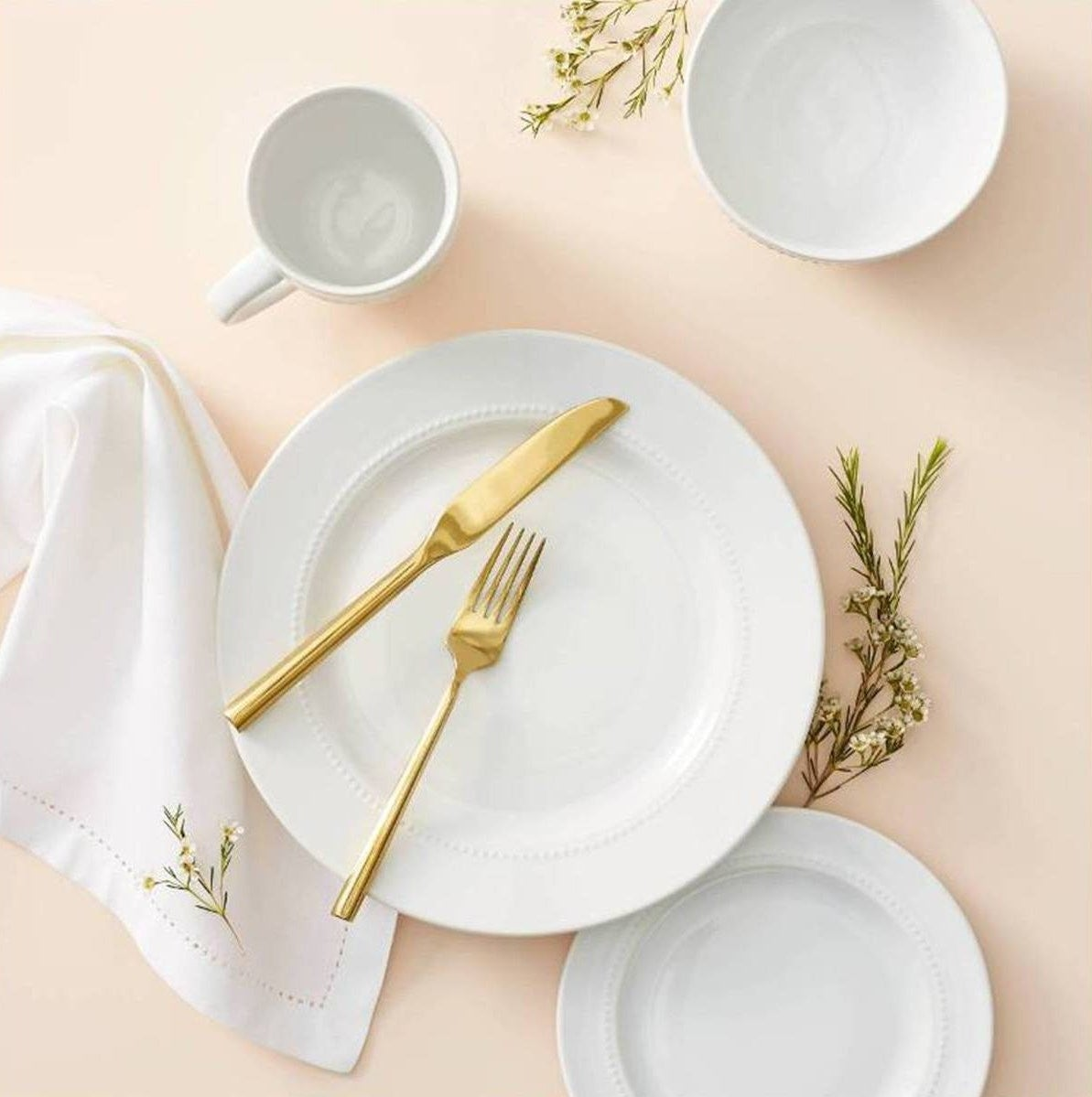 all white dinnerware with delicate beaded rims