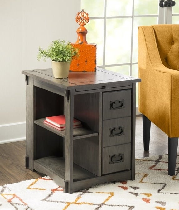 The table in gray, featuring three drawers and shelving