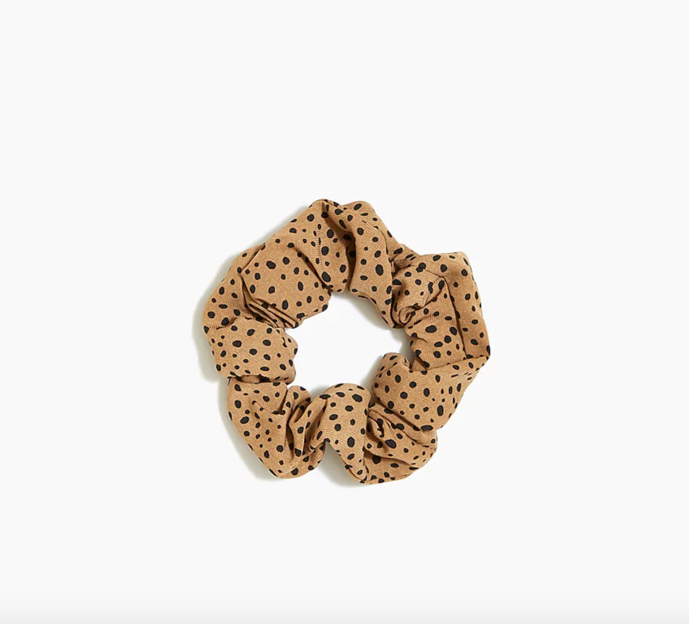 the tan scrunchie with black polka dots