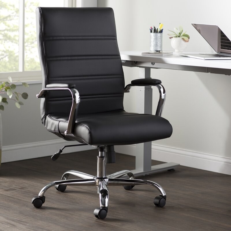 The faux-leather high-back chair in black